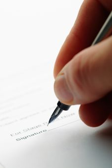Man Holding A Pen While Doing Document. Royalty Free Stock Image