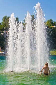 The Boy Bathes In A Fountain Royalty Free Stock Photos
