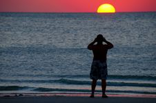 Free Man Photographing A Colorful Ocean Sunset Royalty Free Stock Images - 27114089