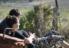 Romantic Young Couple Having Picnic In Countryside Stock Images