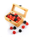 Free Candies In A Wooden Box With Some Outside Royalty Free Stock Photography - 27122697