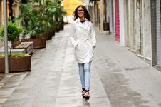 Free Woman With Eyesglasses Walking In The Street Stock Photos - 27124783