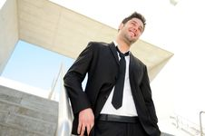 Free Attractive Young Businessman Smiling Stock Images - 27125224