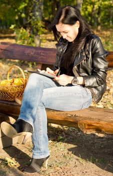 Woman In The Country With A Tablet Royalty Free Stock Image