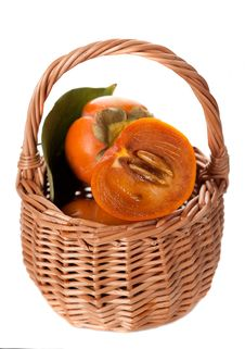 Free Basket With Persimmon On A White Background Stock Images - 27159874