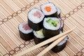 Free Chopsticks And Sushi On Bamboo Mat Stock Photos - 27160233