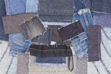 Background Of Overlapping Pieces Of Denim. Royalty Free Stock Image