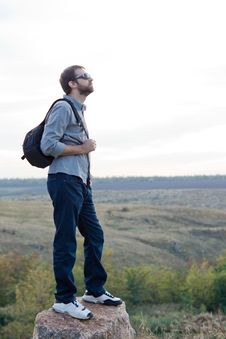 Free Man Exploring With A Backpack Royalty Free Stock Photo - 27169175