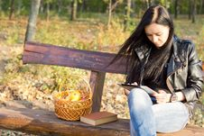 Woman On Park Bench Using A Tablet Stock Images