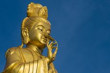 Free Standing Golden Guanyin With Bluesky Stock Photos - 27171743