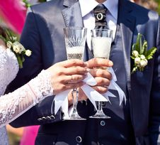 Glasses With Champagne In Hands Stock Photography