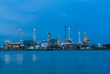Free Petrol Refinery Station Along River At Twilight Stock Photo - 27175360