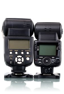 Couple Of Different Flash Speedlights. Royalty Free Stock Photos