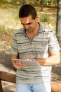 Free Man Typing On A Tablet Stock Photo - 27180380