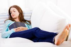 Free Beautiful Girl Sleeping Peacefully On The Couch Royalty Free Stock Photos - 27180058