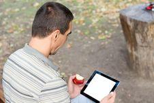 Man Using A Touchscreen Tablet Stock Photos