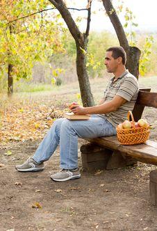 Free Man Sitting Eating Apples Stock Photos - 27180243
