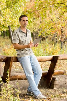 Free Man Using A Tablet In Woodland Stock Photography - 27180322