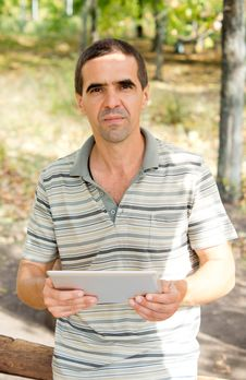 Free Man Holding A Tablet Stock Photos - 27180413