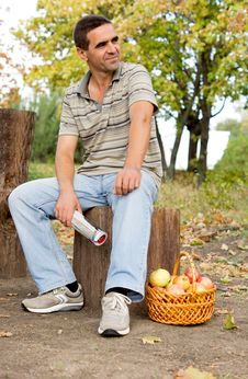 Free Man Seated On A Tree Trunk Stock Photos - 27180433