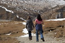 Free Two Tourists Visiting Mountains Royalty Free Stock Image - 27180856