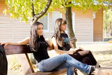Free Two Female Friends Sitting On A Bench Stock Image - 27182861