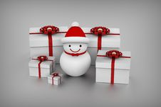 Free Snowman And Gift Boxes Royalty Free Stock Photo - 27186185