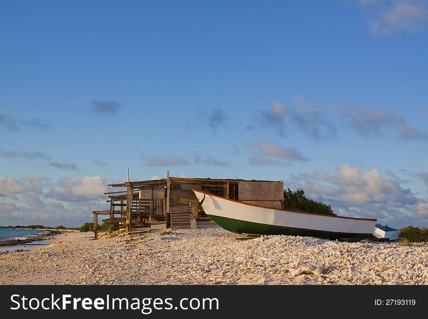 Shack on Beach with Boat