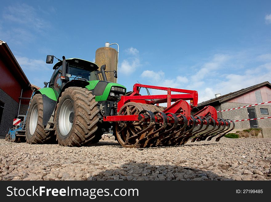 Modern tractor with a plow