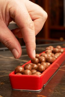 Free Man Stealing Chocolate Balls Stock Photography - 2720922