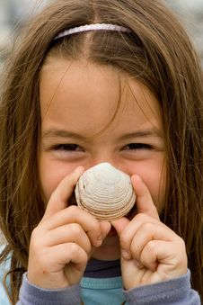 Happy Child With A SeaShell