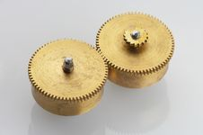 Two Old Golden Cogwheels Stock Image