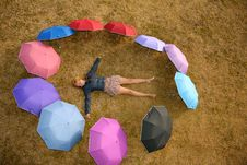 Free Woman In The Ring Of Umbrellas Royalty Free Stock Photos - 2728418