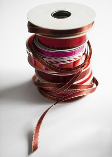 Free Vertical Stack Of Holiday Ribbon Spools Royalty Free Stock Image - 27201926