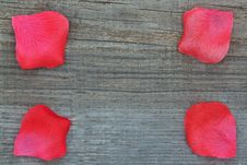 Free Rose Petals On The Wooden Texture. Stock Images - 27209304