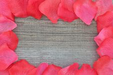 Free Rose Petals On Textured Wood. Royalty Free Stock Photo - 27209305
