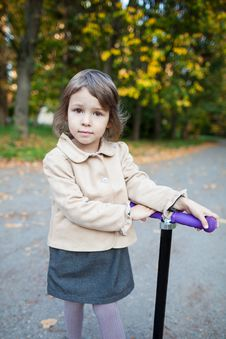Free Preschooler Girl Outdoor In The Park With Scooter Royalty Free Stock Photos - 27209998