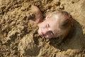 Free Little Girl Lying On Sand Stock Photo - 27214180