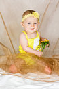 Free Beautiful Little Girl Sits With Yellow Flower Royalty Free Stock Photography - 27214927