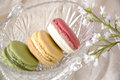 Free Macarons In Glass Basket With Flowers Royalty Free Stock Image - 27235006