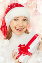 Free Cheerful Woman In A Christmas Hat With A Gift Royalty Free Stock Photos - 27239668