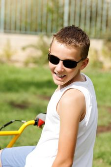 Free Boy In Glasses On A Bike Outside Royalty Free Stock Image - 27239086