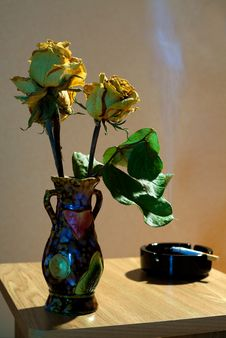 Vase With Yellow Dried Roses And Ashtray Royalty Free Stock Images