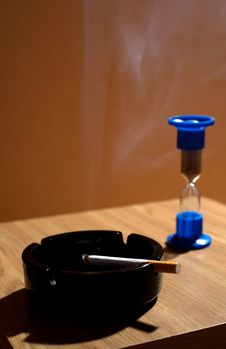 Free Ashtray With Cigarette And Hourglass Stock Photos - 27239603