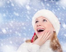 Free Happy Funny Girl In A Christmas Hat Royalty Free Stock Photography - 27239677