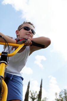 Free Pretty Boy On A Bike Outside Stock Photo - 27239690