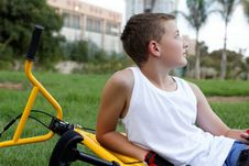 Free Boy With A Bicycle Outside Stock Image - 27239741
