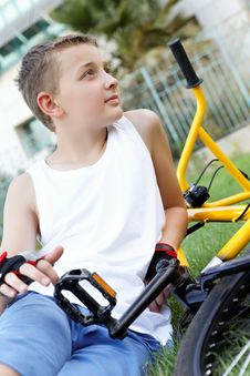 Free A Boy And A Bike Outside Stock Photography - 27239762