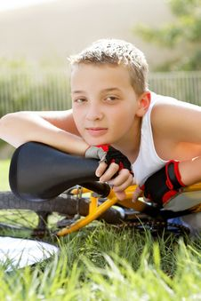 Free Sport Boy With A Bicycle Outside Royalty Free Stock Photo - 27239845