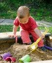Free Child Playing In Sandbox Royalty Free Stock Photo - 27249505